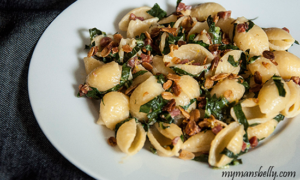 Pasta shells with a prosciutto and lemon crunch topping