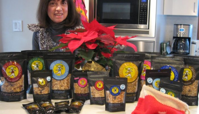 Deborah and Golden Girl Granola products in kitchen