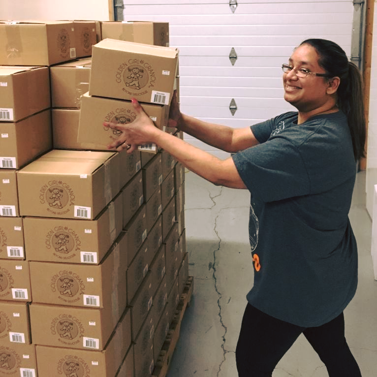 Baker stacking granola order boxes