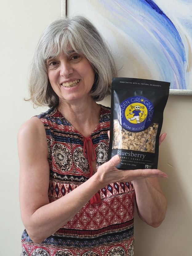Owner Deborah O'Kelly showing Bluesberry granola bag