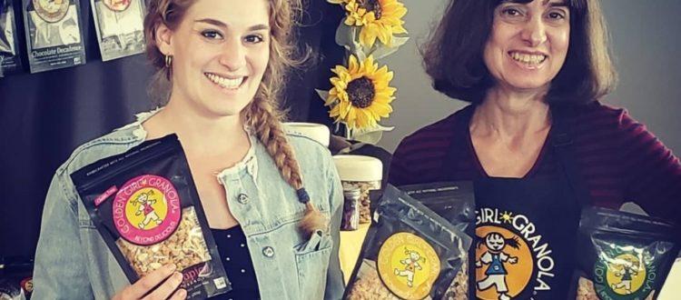 Deborah and Jacquie display granola flavors